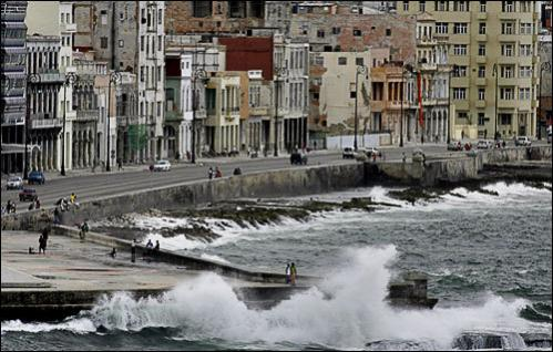 People stand along the Malecon, or sea walk, as strong winds caused by Tropical Storm Fay create waves in Havana, Monday, Aug. 18, 2008. Fay made landfall in Key West, Florida, after crossing central Cuba without causing major damages.