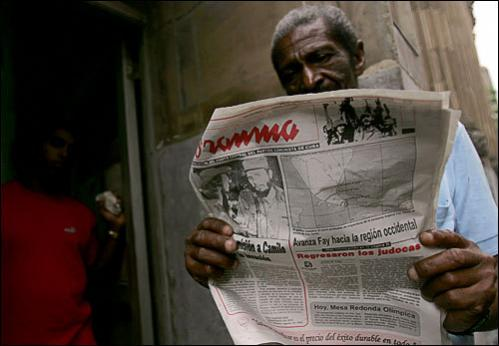 A Cuban man reads Granma newspaper with news of tropical storm Fay in Havana on August 18, 2008. Tropical storm Fay moved towards hurricane strength as it struck Cuba and barreled toward the Florida Keys after claiming at least 40 lives in the Dominican Republic and Haiti.