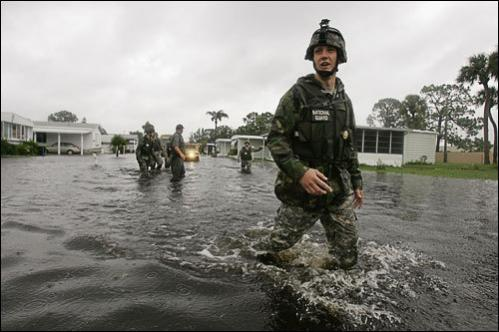 After Tropical Storm Fay flooded streets, National Guard troops search for residents in the Lamplighter Village neighborhood in Melbourne, Fla., Thursday, Aug. 21, 2008.