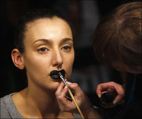 A model has makeup applied before a show at the Buenos Aires fashion week August 20, 2008.