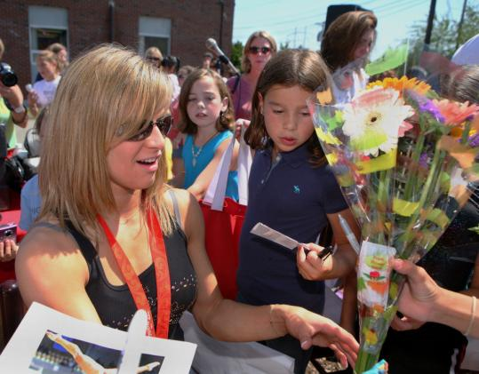 Alicia Sacramone accepted flowers and signed autographs during festivities celebrating her homecoming yesterday in Burlington.