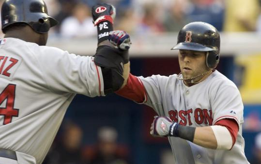 Dustin Pedroia is a popular fellow as he's greeted by David Ortiz after his 13th HR of the year gave the Sox a 1-0 lead in the first.