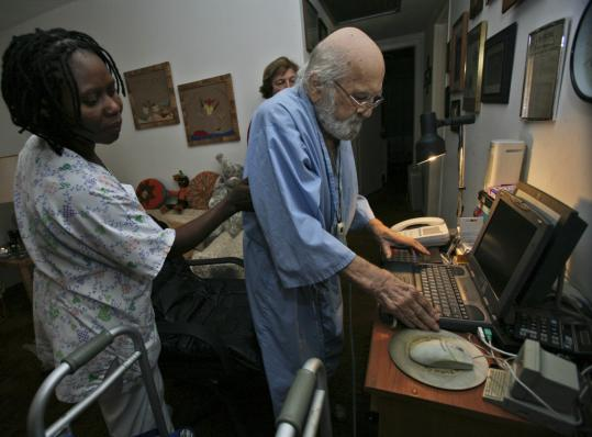 Nurse's aide Anelia Santfleur (left) helped Martin Hornung, an Auschwitz survivor, sit at the computer earlier this month.