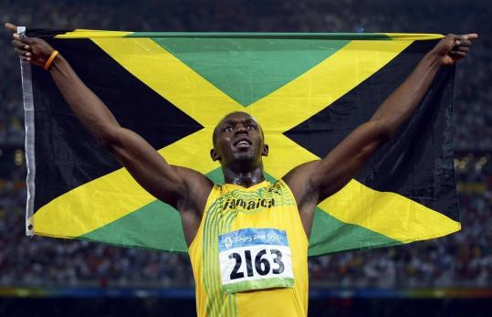Usain Bolt, winner of three of Jamaica's six gold medals, shows off his pride in his country after setting a world record in the 100.