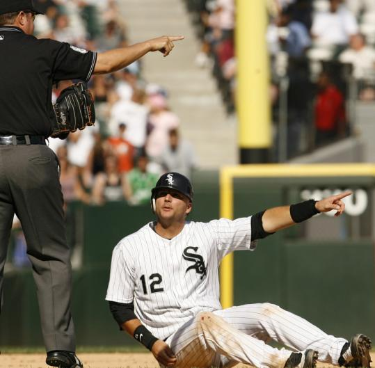 Umpire Doug Eddings agreed with A.J. Pierzynski that he'd been interfered with running to third, and the call helped the White Sox rally past the Rays.
