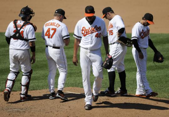Daniel Cabrera (center) and the Orioles were downbeat after the Baltimore starter failed to get out of the fourth inning.