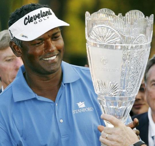 Vijay Singh had plenty to smile about after winning The Barclays in a playoff gave him the FedEx Cup points lead.