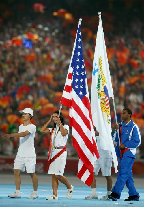 Archer Khatuna Lorig of the United States of America carries her country's flag into the National Stadium during the Closing Ceremony.