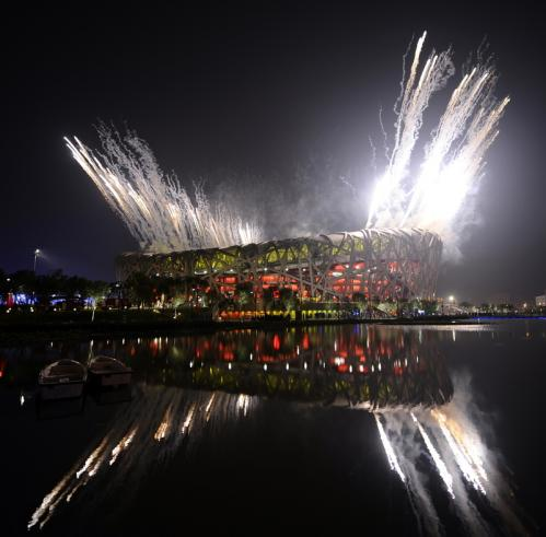 The night sky is illuminated during the fireworks display at the National Stadium.