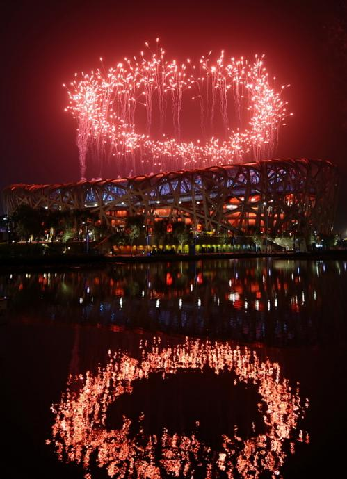 Fireworks light the night sky above the National Stadium.