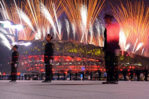 Fireworks light up the sky over the National Stadium, also known as the Bird's nest, at the start of the closing ceremony of the 2008 Beijing Olympic Games.