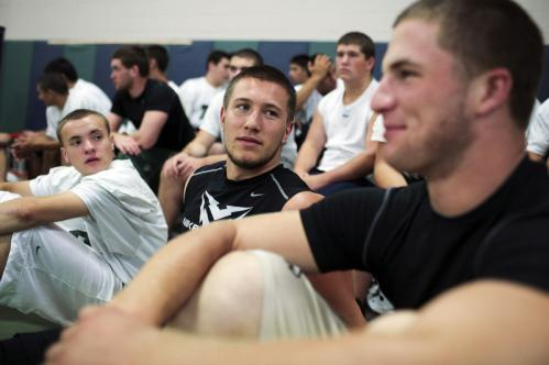 Dartmouth senior football player Sean Sylvia (center) chats with Arthur Lynch-Fontaine (right).