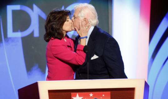 Senator Edward M. Kennedy got a kiss from his wife, Victoria Reggie, after addressing the Democratic convention last night.
