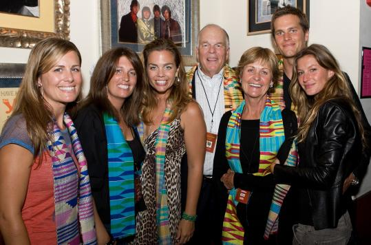 Tom Brady at the Boston for Africa event with (from left) his sisters Julie, Maureen, and Nancy, father Tom Sr., mother Galynn, and Gisele Bundchen.