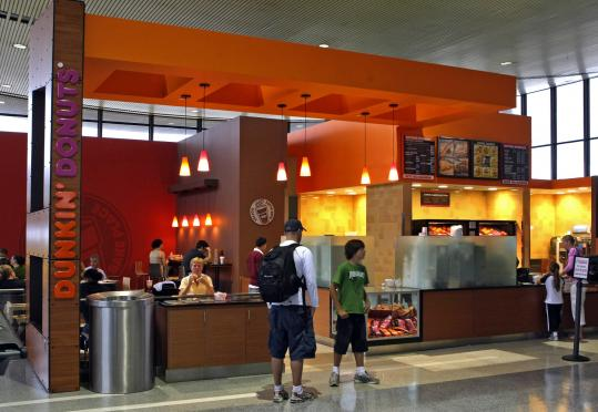 Dunkin' Donuts occupies about 1,000 square feet at Logan's upgraded Terminal C food court - the chain's largest airport store in the country. In all, seven eateries will be available at the food court. Terminal C's concession sales rose 12 percent in a year.