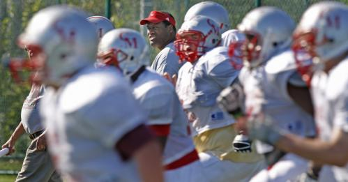 Catholic Memorial volunteer assistant coach and former Patriots lineman Brent Williams keeps a watchful eye over the Knights.