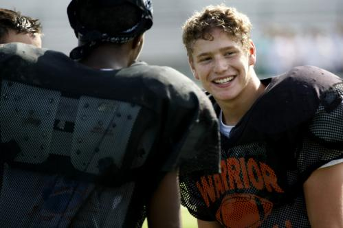 Wayland quarterback Jeff Brewington (left) talks with Elliott Salkis.