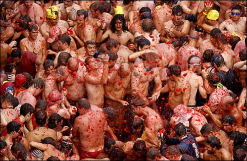 Revelers throw tomatoes during the Tomatina in the town of Bunol, Spain, Wednesday, Aug. 27, 2008.