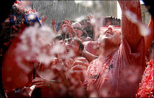 Revelers throw tomatoes during the Tomatina in the small Spanish town of Bunol, Spain, Wednesday, Aug. 27, 2008.