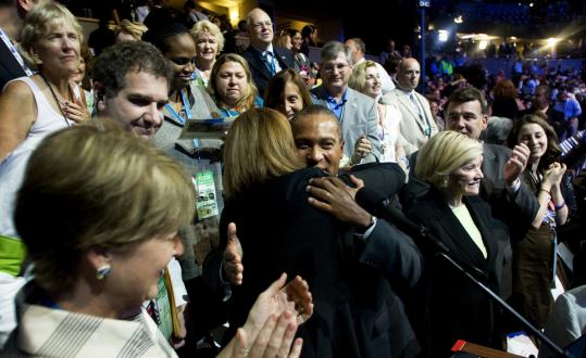 Governor Deval Patrick hugged Massachusetts Senate President Therese Murray yesterday during the roll call.