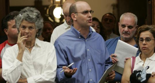 Andrew Tarsy (center) was a top ADL official when he spoke at a Watertown hearing last August.