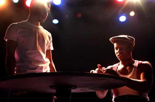 Kevin Joseph (left) of Dorchester plays a Lincoln figure and Rondale Davis (right), also of Dorchester, plays Booth in ''Topdog/Underdog,'' performed by the MissionSAFE summer theater group.
