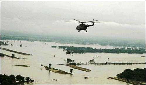 A helicopter carrying Indian Prime Minister Manmohan Singh and Congress party president Sonia Gandhi makes an aerial survey of flood affected areas in Bihar, India, Thursday, Aug. 28, 2008. The death toll from this year's monsoon has already climbed past 800, and now some 1.2 million people have been marooned, and about 2 million more affected in the impoverished state of Bihar, where the Koshi river has burst its banks, breached safety embankments and submerged all roads leading to the region.