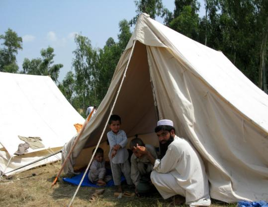 An estimated 200,000 people, including this family, have fled their homes in tribal areas of Pakistan.