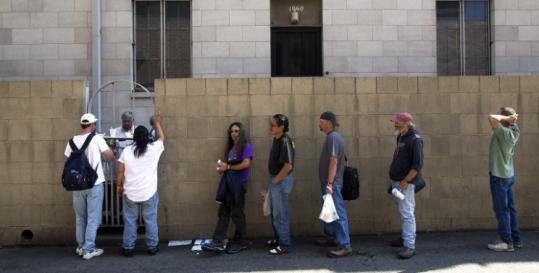 Homeless people lined up at St. Francis Interfaith Center for free food blocks away from the convention yesterday.