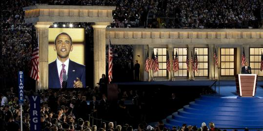Barack Obama's image was shown on a large screen last night at Invesco Field as he accepted the Democratic nomination for president.