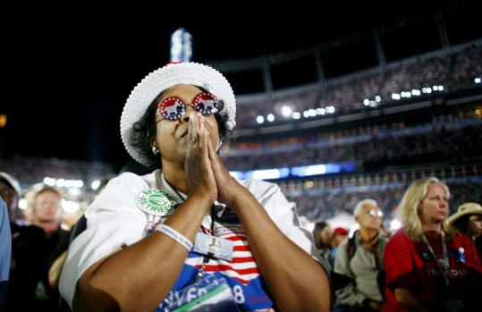 Eric Thayer/Reuters A delegate listened intently as Senator Barack Obama gave his acceptance speech last night at Invesco Field at Mile High Stadium.