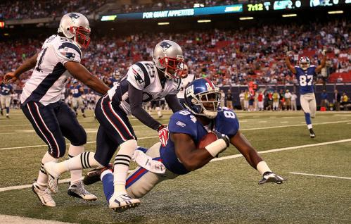 Tight end Darcy Johnson (84) of the New York Giants scores a touchdown against the New England Patriots.