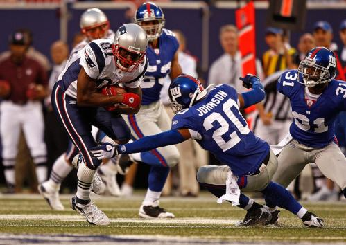 Wide receiver Randy Moss (left) of the New England Patriots makes a catch during a preseason game against the New York Giants.