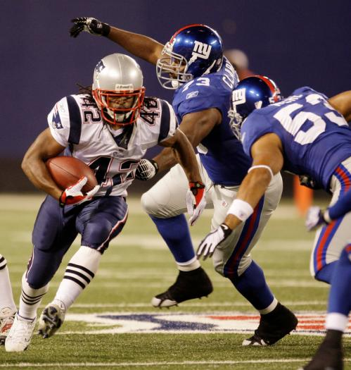 New York Giants defensive tackle Jeremy Clark (73) tries to catch up to New England Patriots BenJarvus Green-Ellis (42) as he runs in the fourth quarter.
