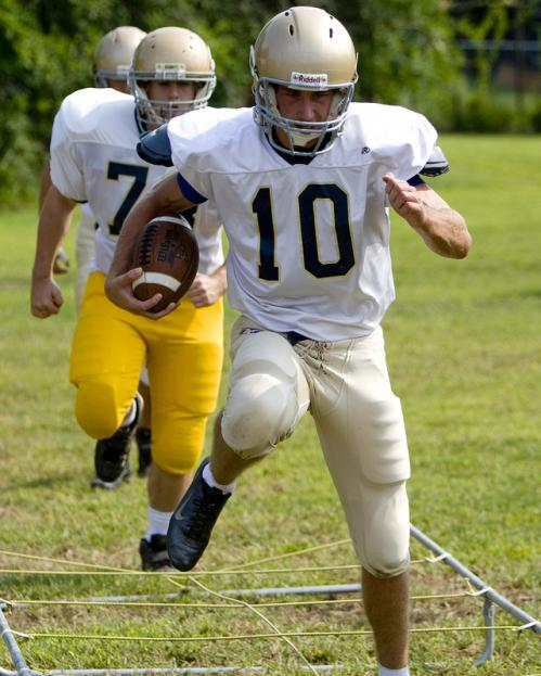 Coyle & Cassidy's Conor Henry (10) runs an agility drill during practice in Taunton.