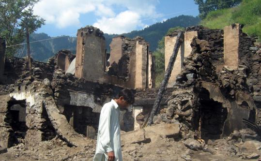 A man walked over the rubble of a house hit in fighting yesterday between militants and Pakistani forces in the Swat Valley.