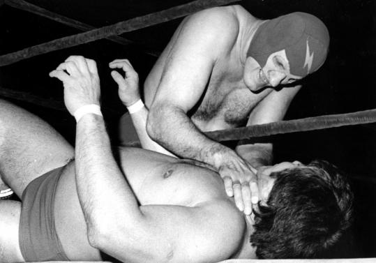 Walter ''Killer'' Kowalski fighting Dean Ho of Hawaii (on bottom). He lifted weights to train for wrestling after being told he was too weak for swimming. The pro wrestler's nickname belied his quiet, gentle personality as a philosopher and a vegetarian.
