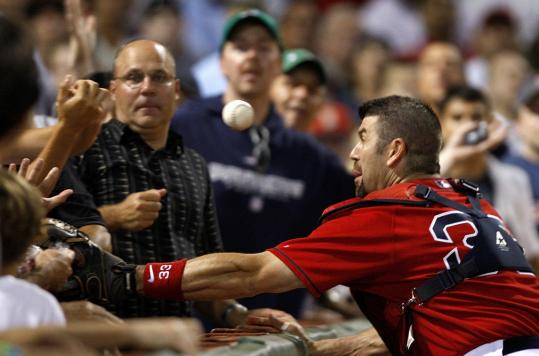 Jason Varitek's hand-eye coordination is a little off as he tries in vain for this foul in the third.