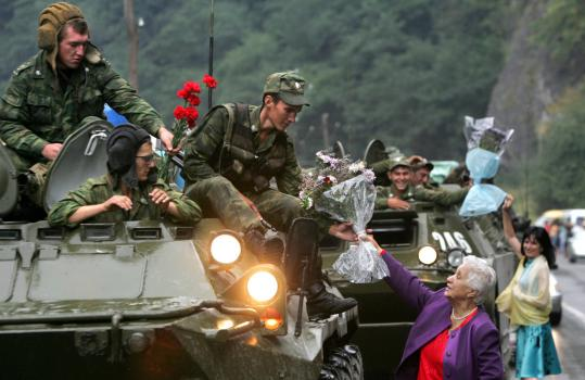As Russian soldiers left South Ossetia yesterday, several women greeted them with flowers near the border with Russia.