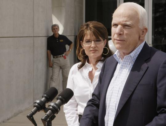 Senator John McCain visited a hurricane command center in Pearl, Miss., yesterday with running mate Sarah Palin.