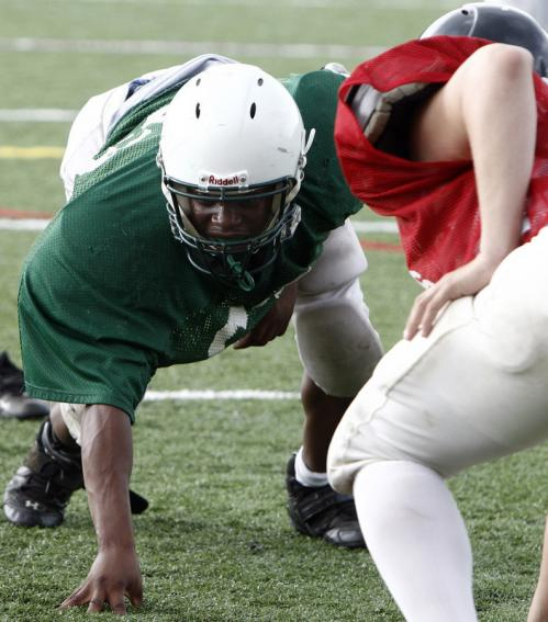 Abington's Kalongi Kabongo (63) gets down as a defensive end during a scrimmage with North Quincy.