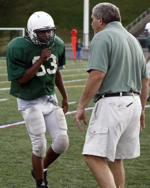 Abington's Kalongi Kabongo (63) gets instructions from head coach James Kelliher during a scrimmage with North Quincy.