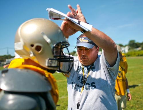 Winthrop coach Sean Driscoll (right) gives instruction during a scrimmage against East Boston.