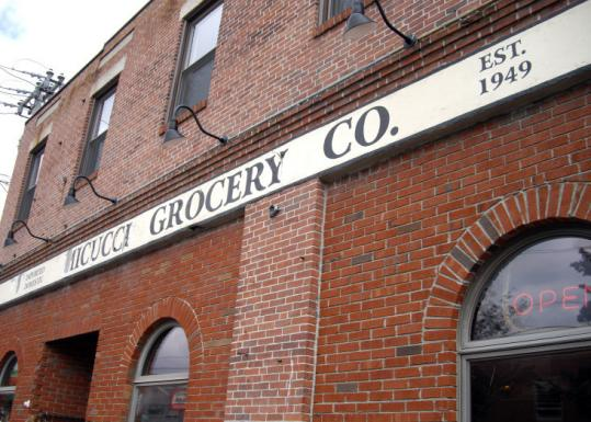 Micucci Grocery Co. offers Sicilian pizza as well as specialty items imported from Italy.