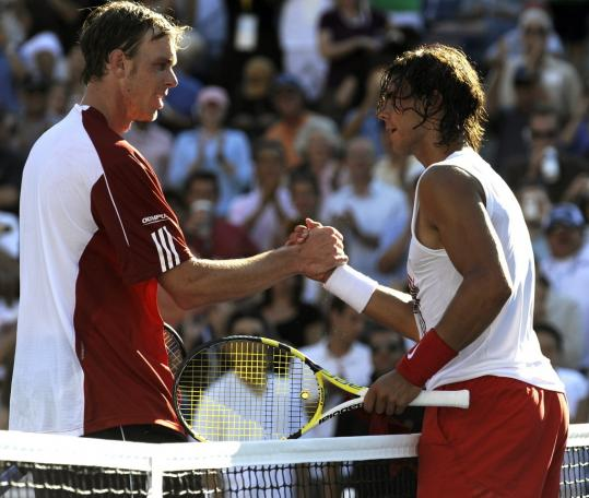 After shaking off a sluggish stretch, Rafael Nadal (right) was congratulated by Sam Querrey.