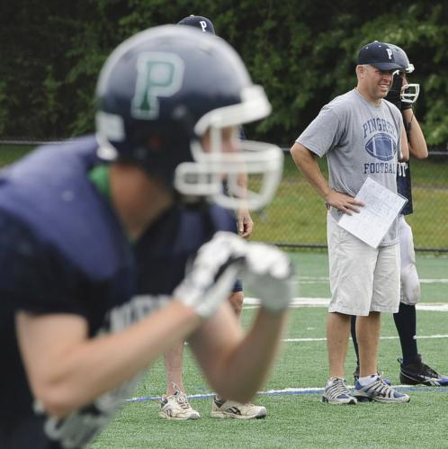 Pingree head coach Chris Powers, right, is seen during a scrimmage against Manchester-Essex.