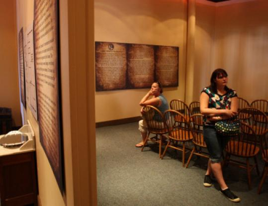Sasha Saxon (left) of North Sutton, N.H., and Kelli Schrader of New York visit Salem's Lizzie Borden exhibit.