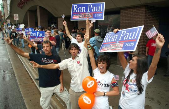 Joyous Ron Paul supporters lined the street yesterday in front of the Target Convention Center in Minneapolis. Paul appeared on stage to the roars of fervent followers, most of whom traveled long distances and waited as long as eight hours to see him.