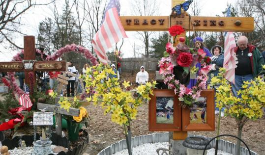 Family members and friends of victims gathered in February at a memorial at the site of the Station fire. A sett
