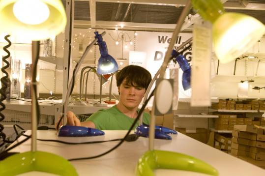 Shane Cronin, a freshman at Worcester State, shops for dorm-room supplies at the IKEA store in Stoughton. He doesn't like clutter and he's cost-conscious.